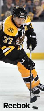 Boston Bruins Patrice Bergeron wearing Reebok hockey gear